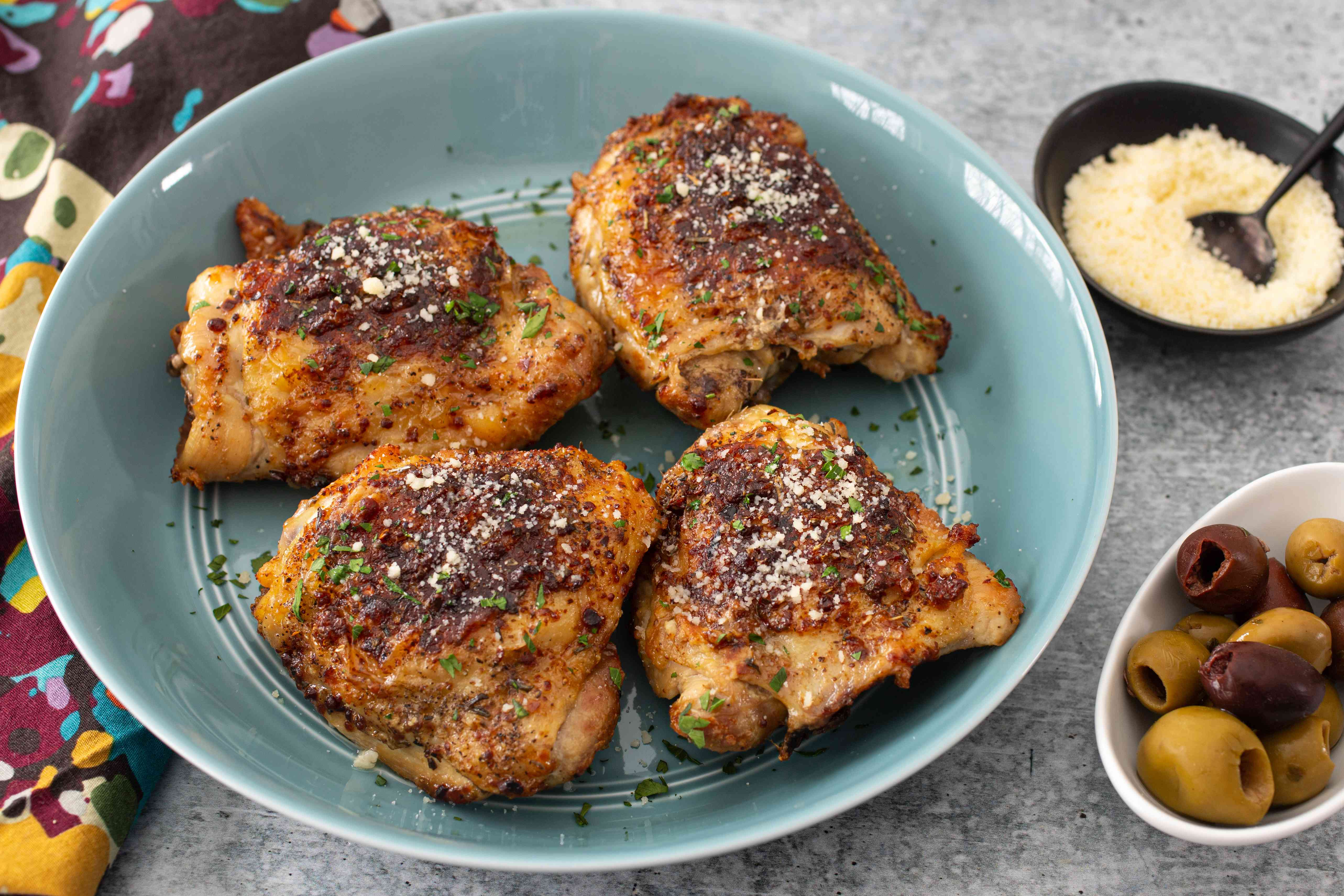 Air fryer chicken thighs with a sprinkling of Parmesan cheese