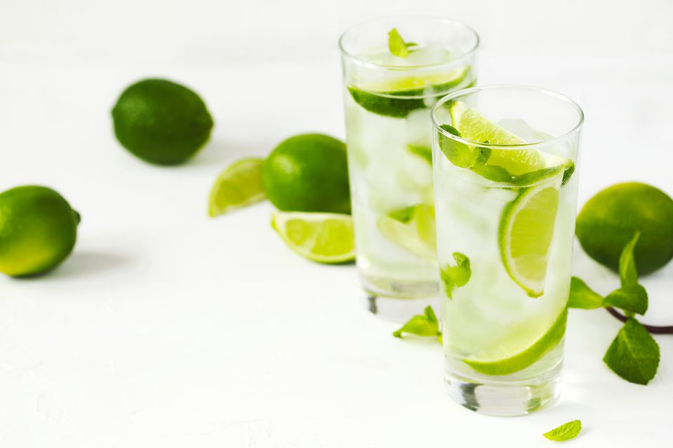 Mojito cocktail with lime and mint in glass
