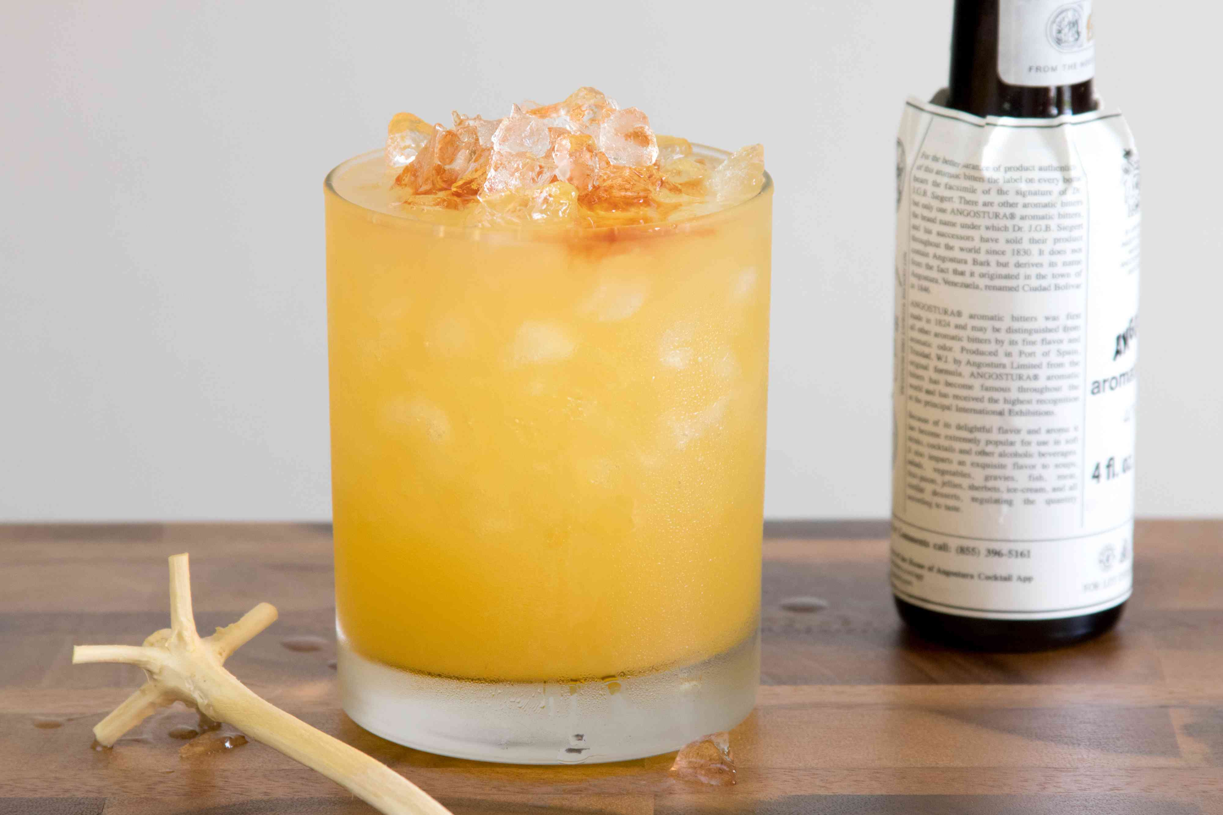 Adding Bitters to a Rum Swizzle Cocktail