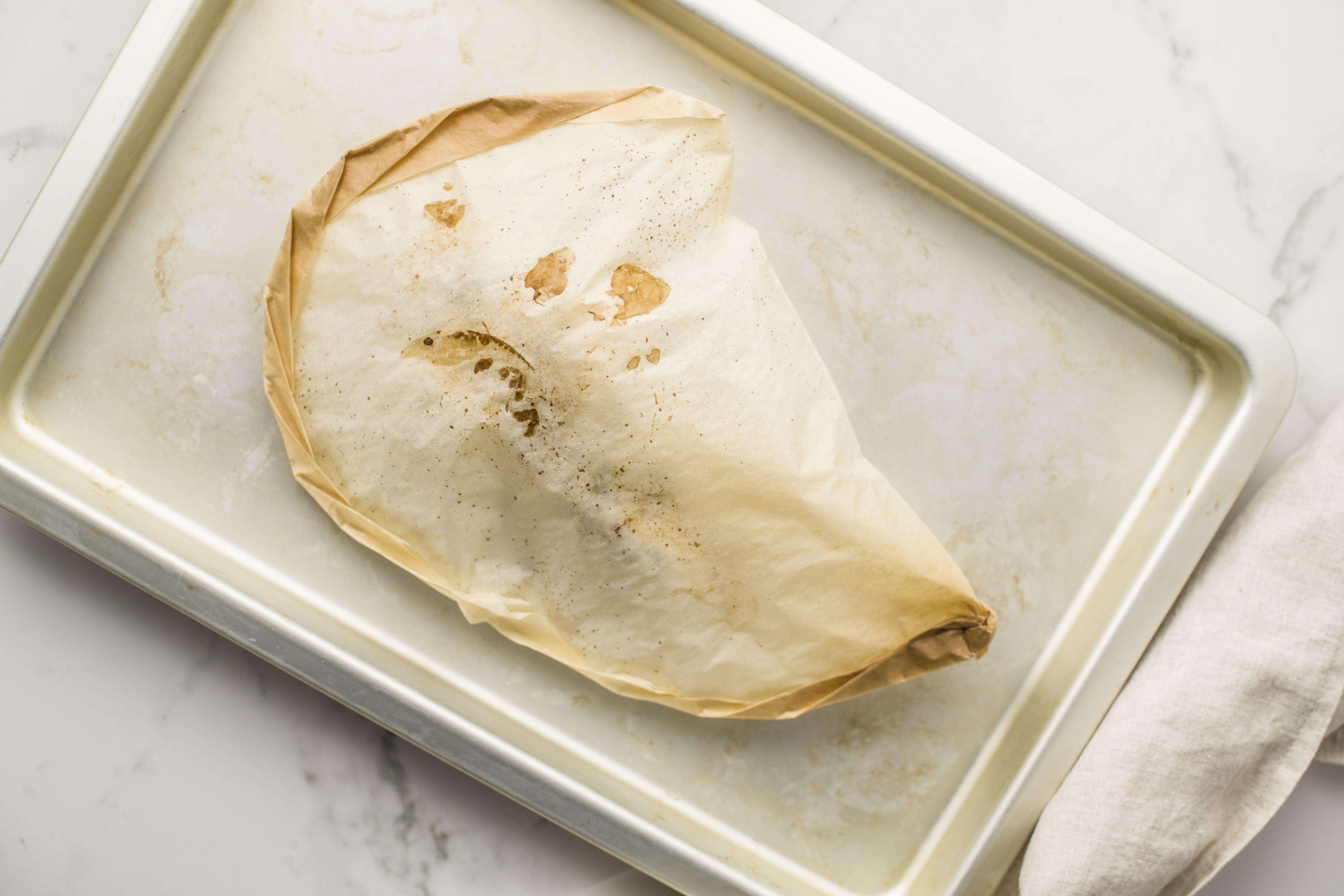 Bake chicken in parchment paper