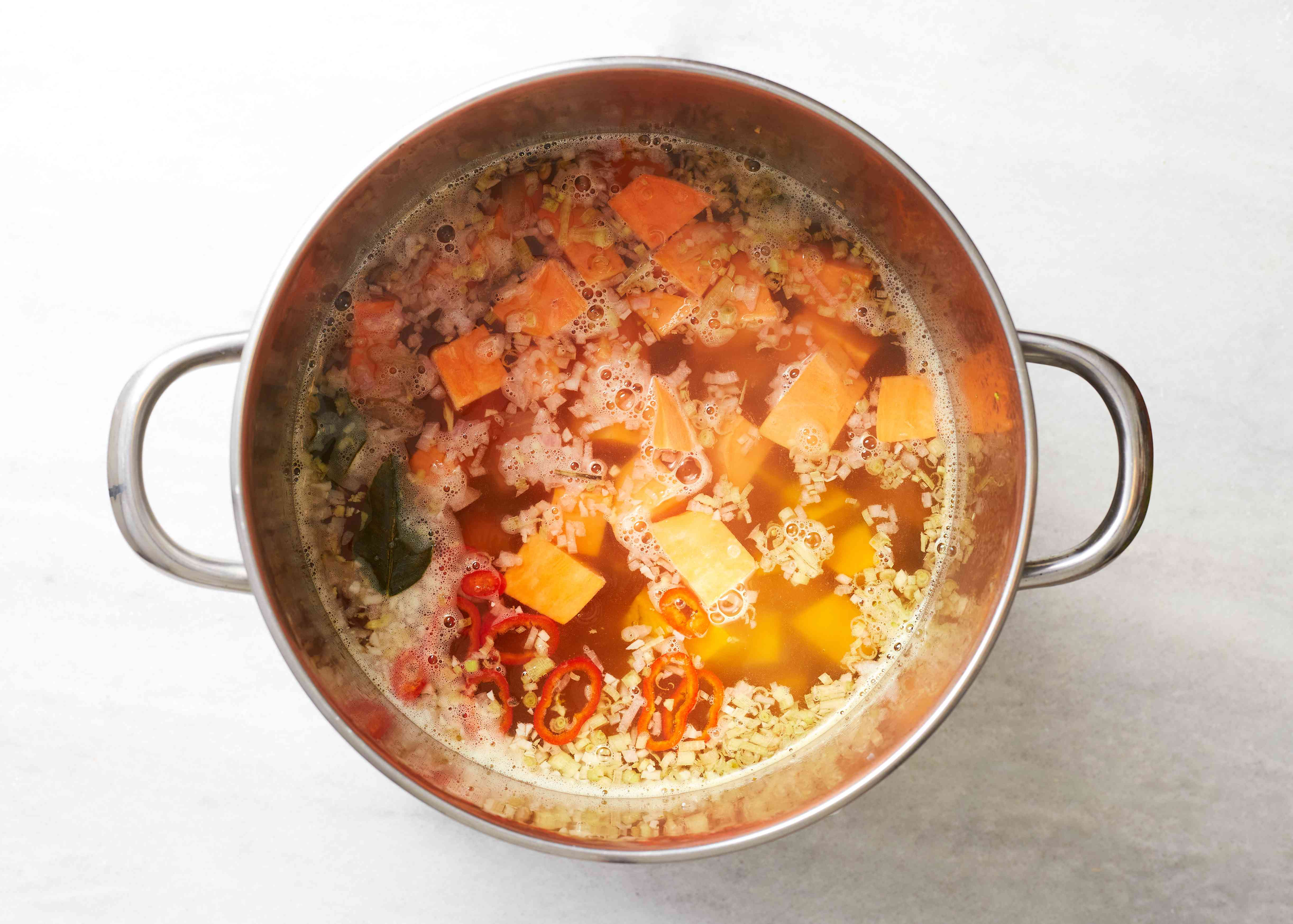 Add the pumpkin and yam to the soup in the pot