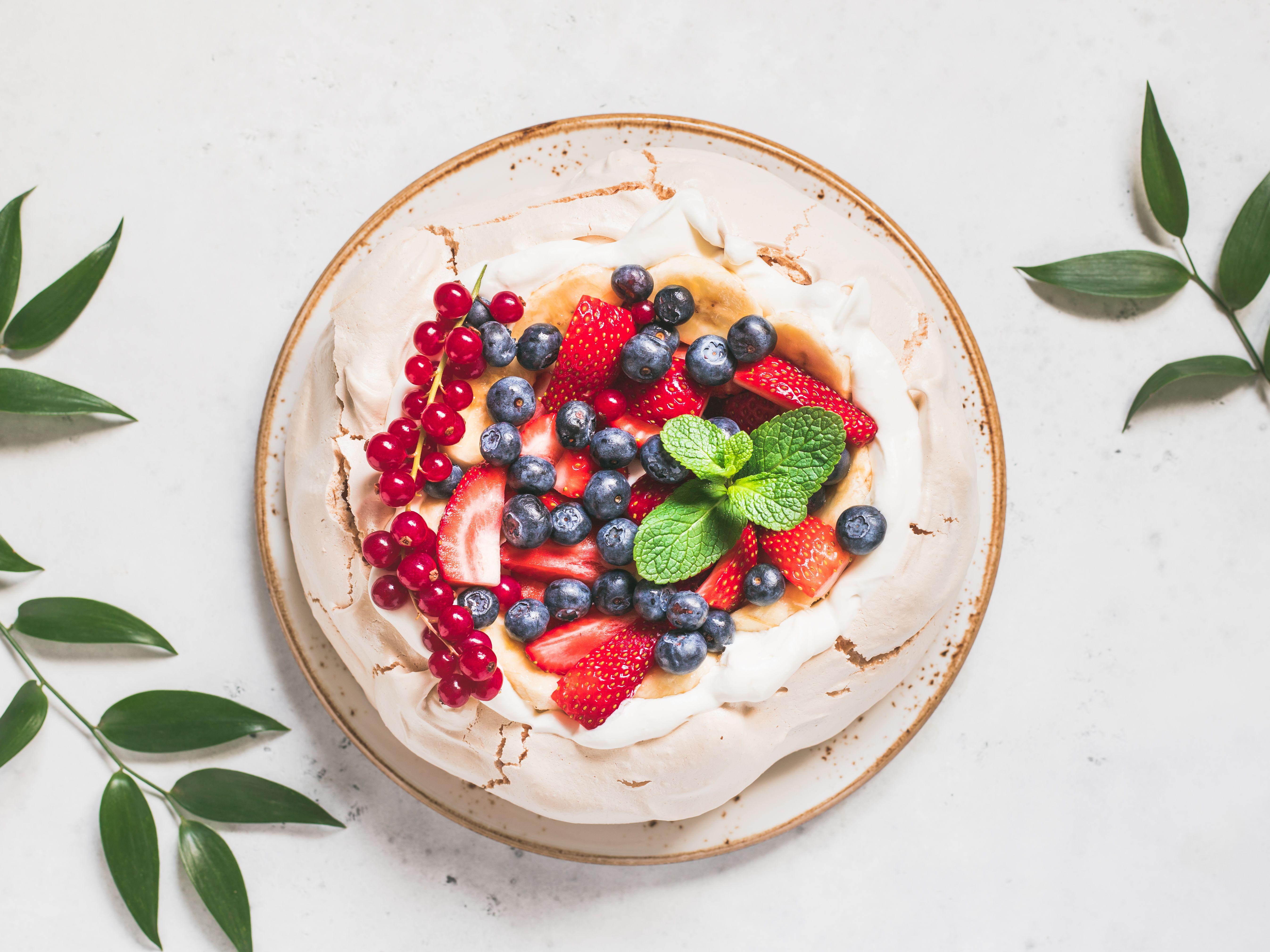 New Zealand Pavlova (meringue, whipped cream, and fruit)