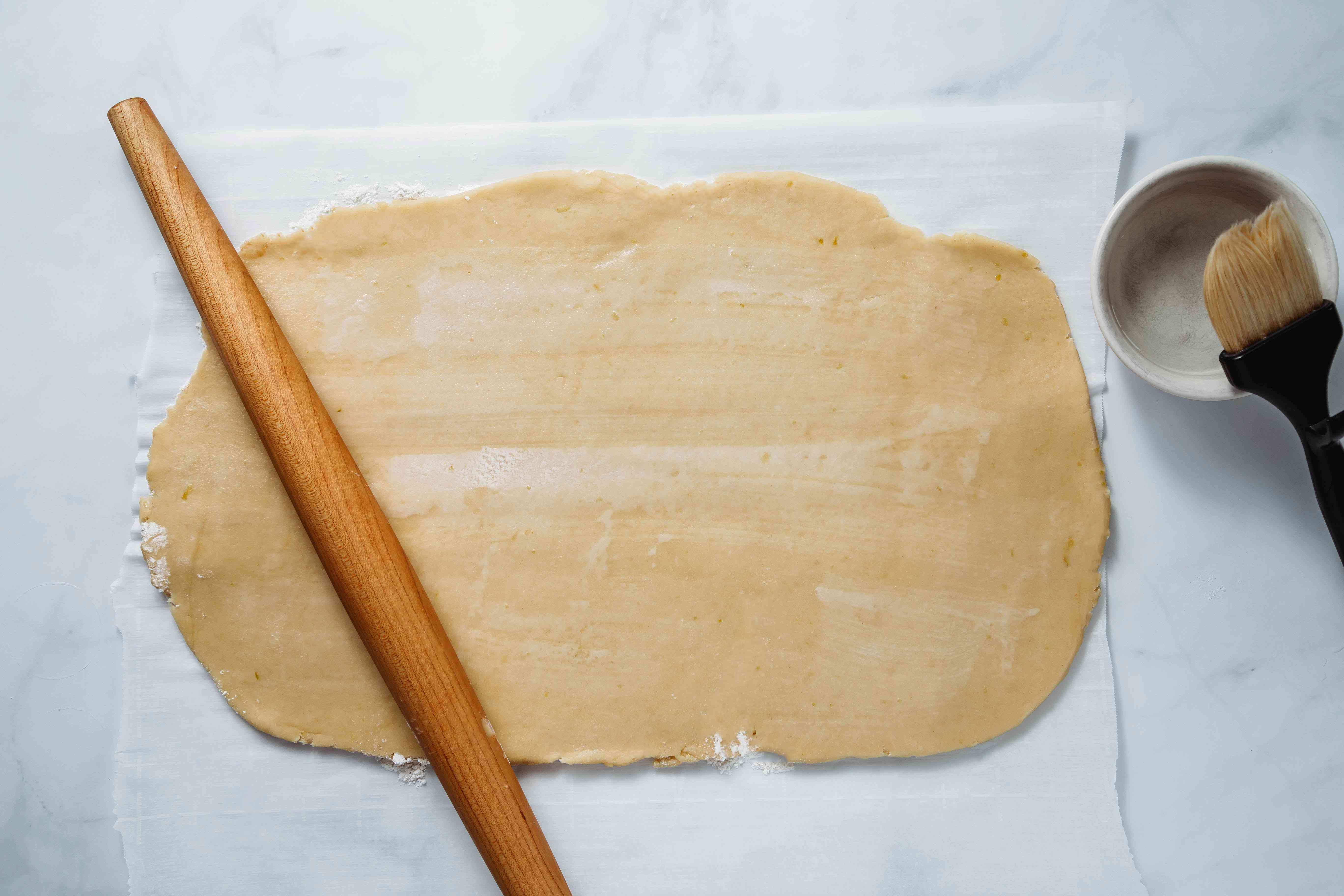 dough rolled out with rolling pin