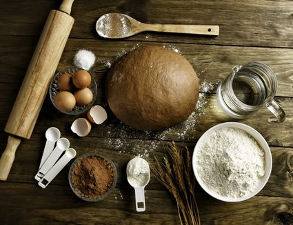 bread making ingredients and loaf of bread