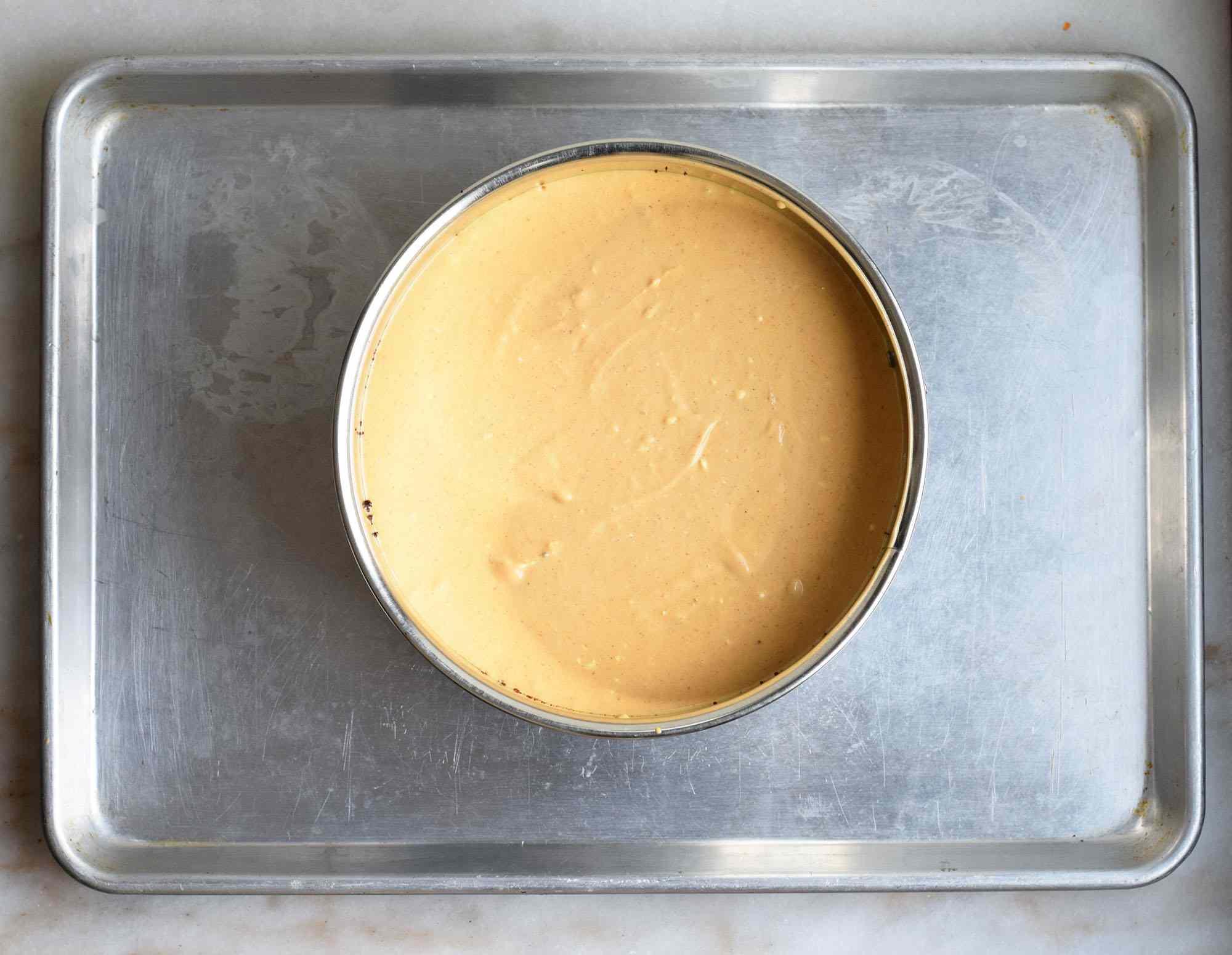 pumpkin cheesecake on a pan