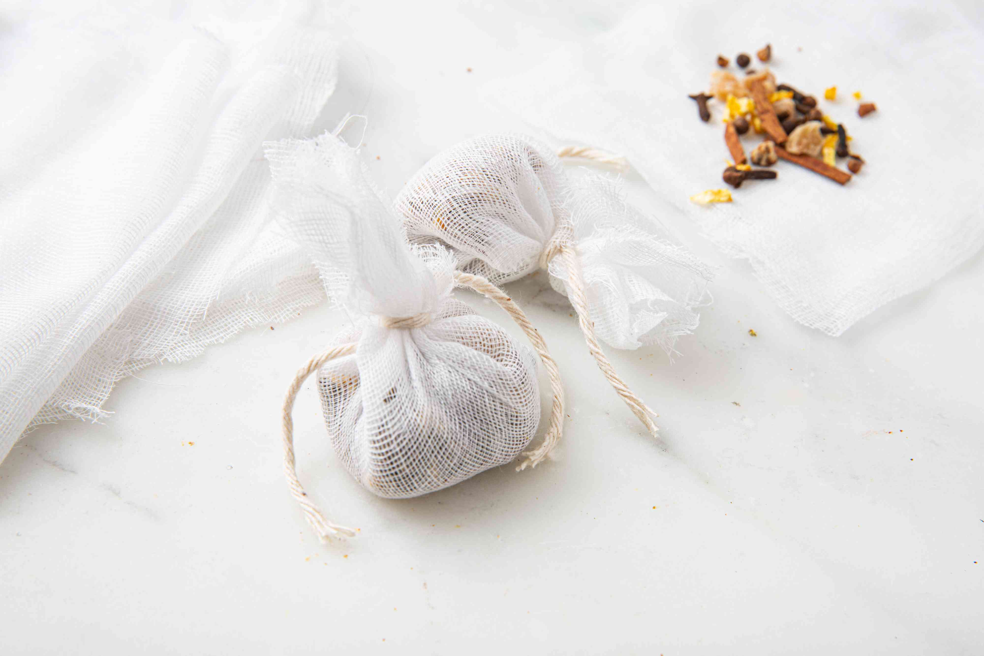 Tie cheesecloth with string, Mulling Spices for Apple Cider and Red Wine