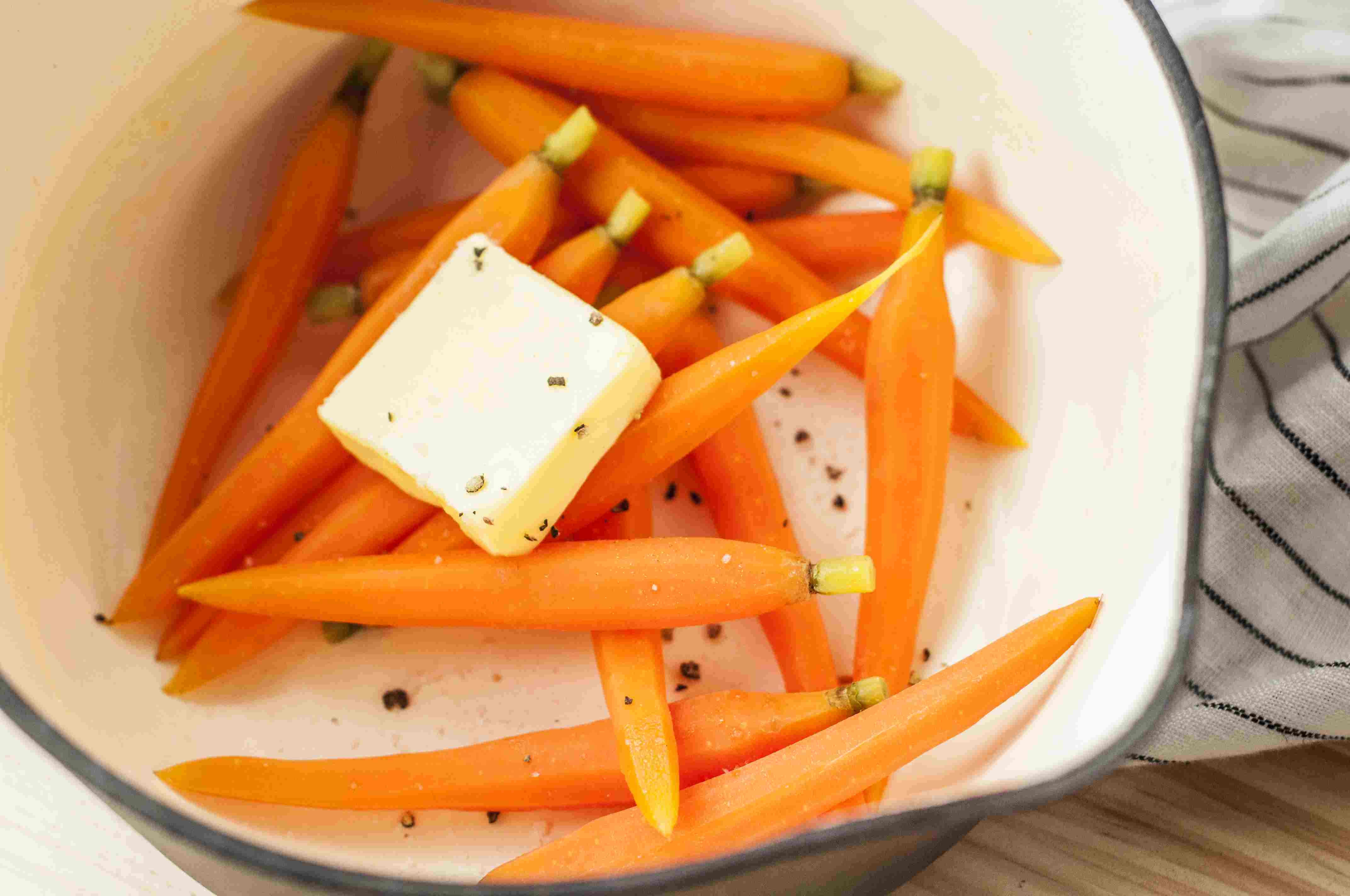 Drain carrots and add butter to saucepan