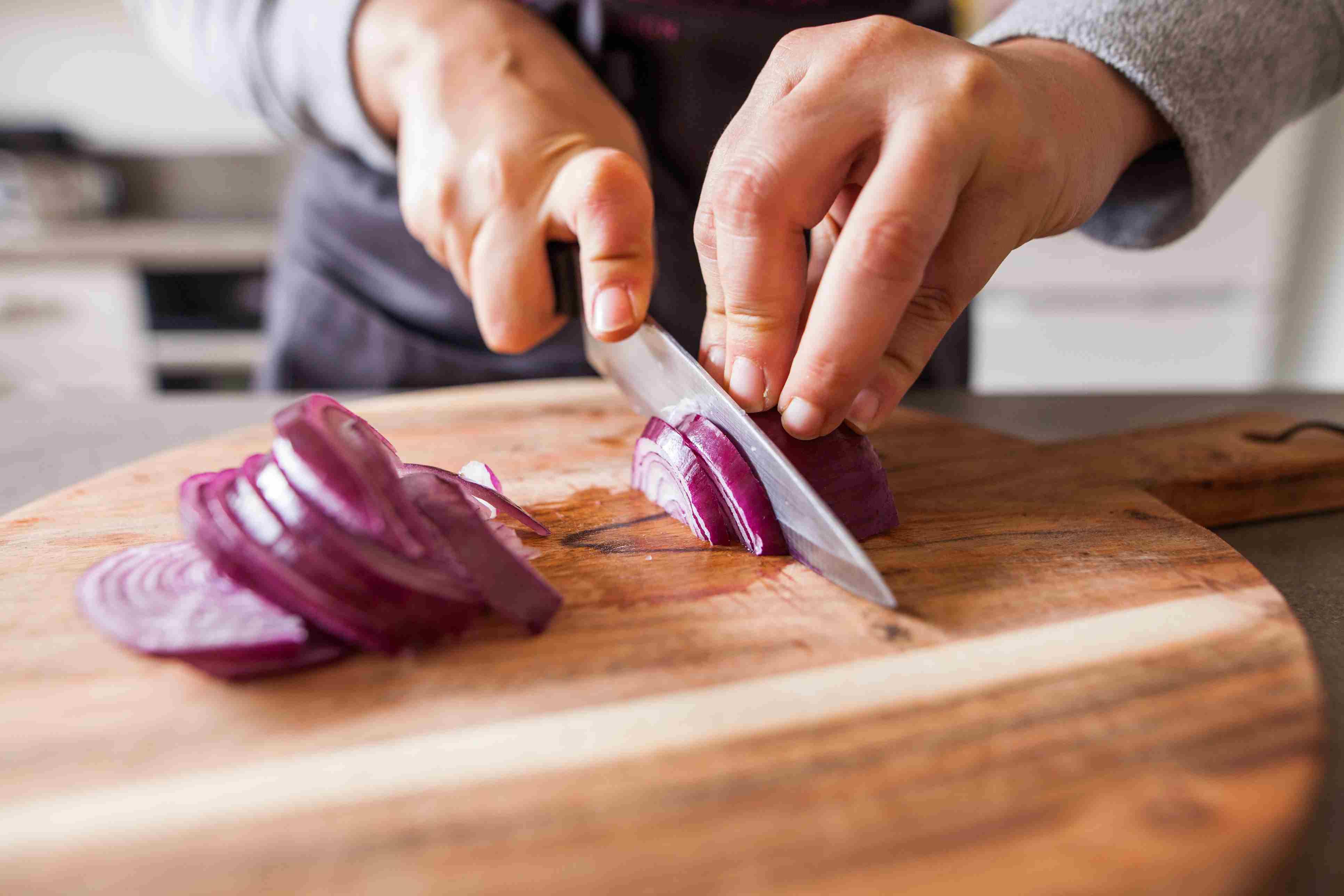 Cutting onions on a cutting board
