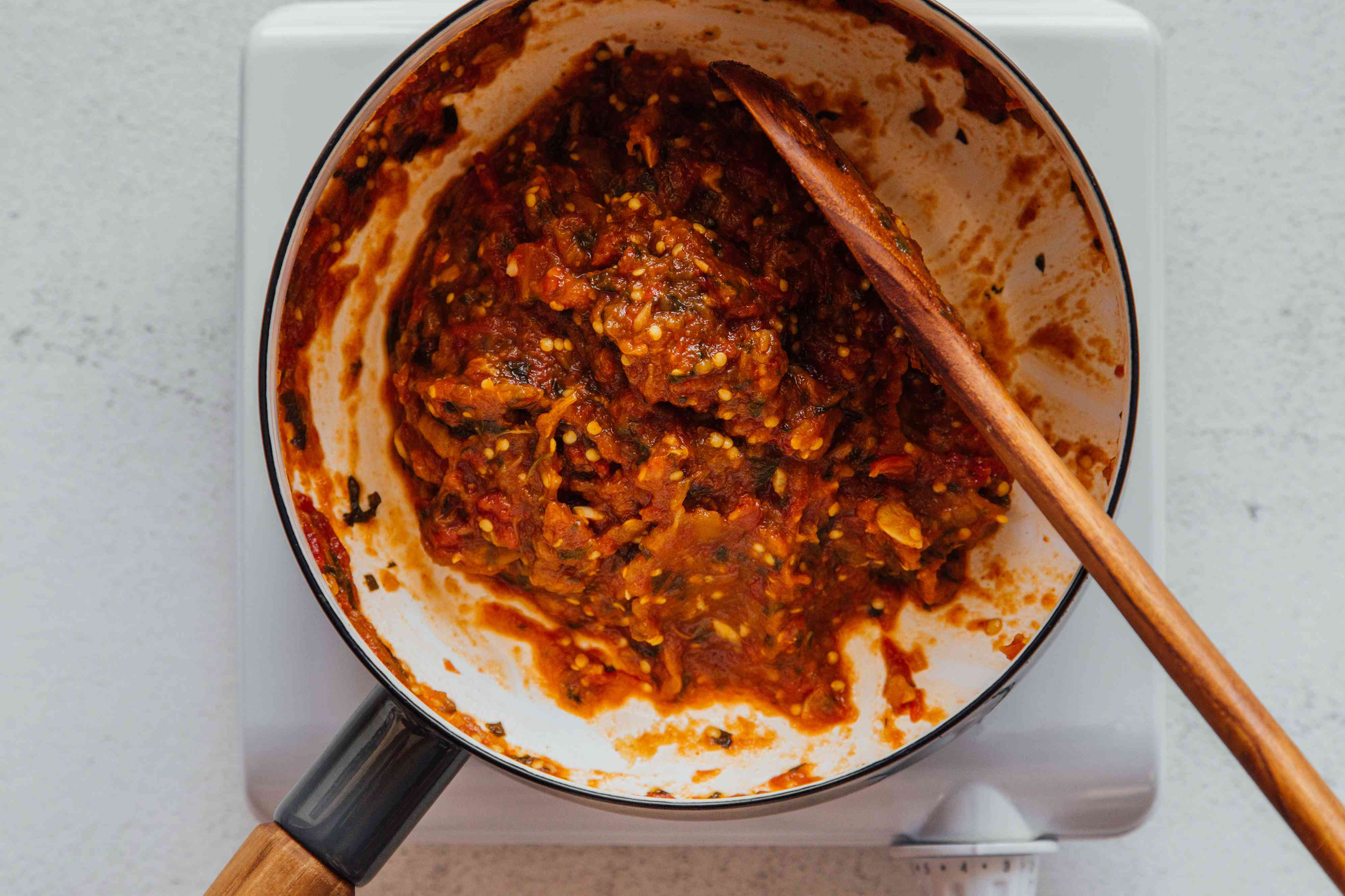 Moroccan Zaalouk (Cooked Eggplant and Tomato Salad) cooking in a pan