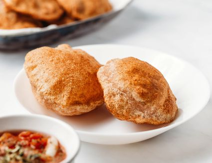 Poori (Fried Indian Flatbread) on a plate