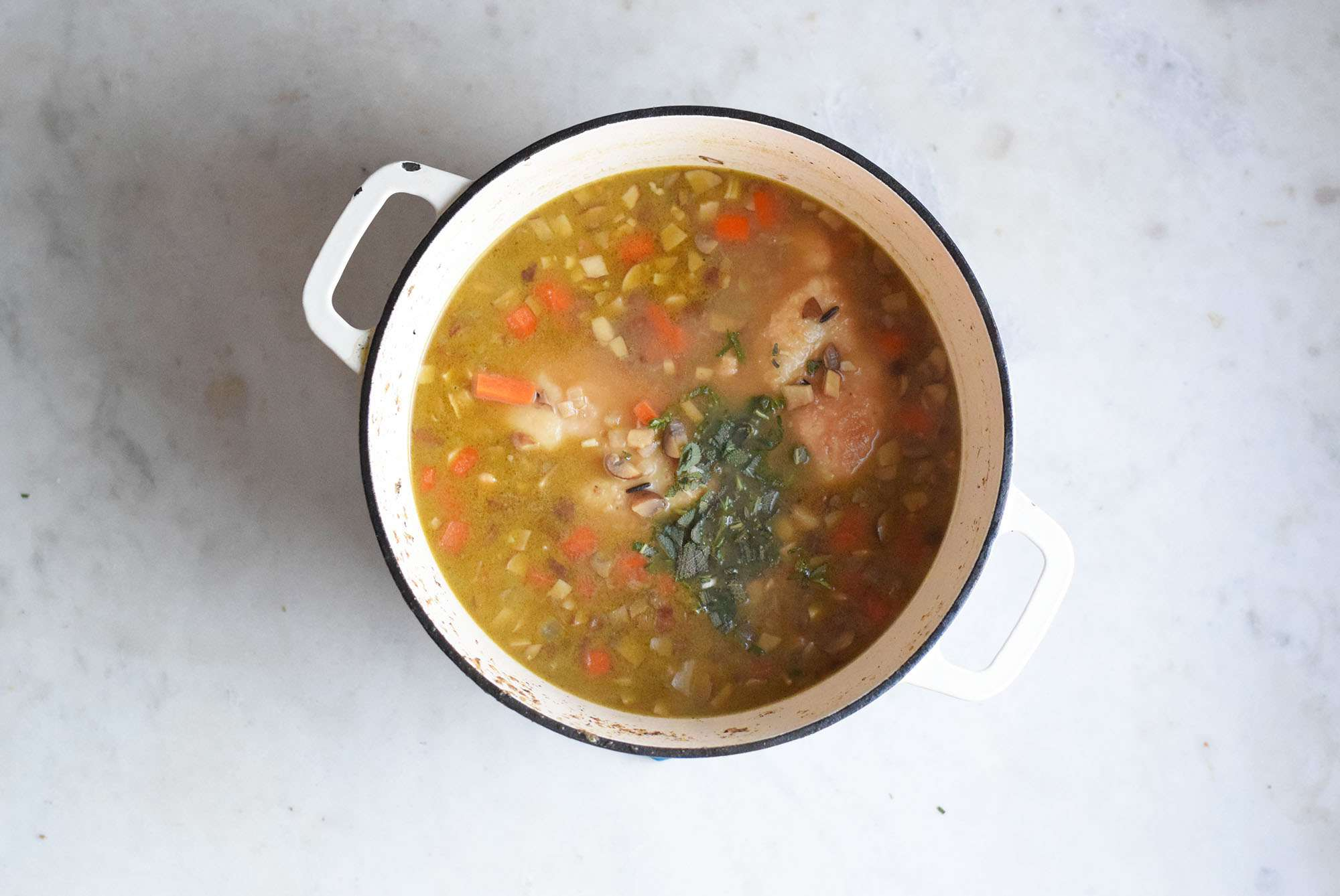 chicken and wild rice in a pot of soup