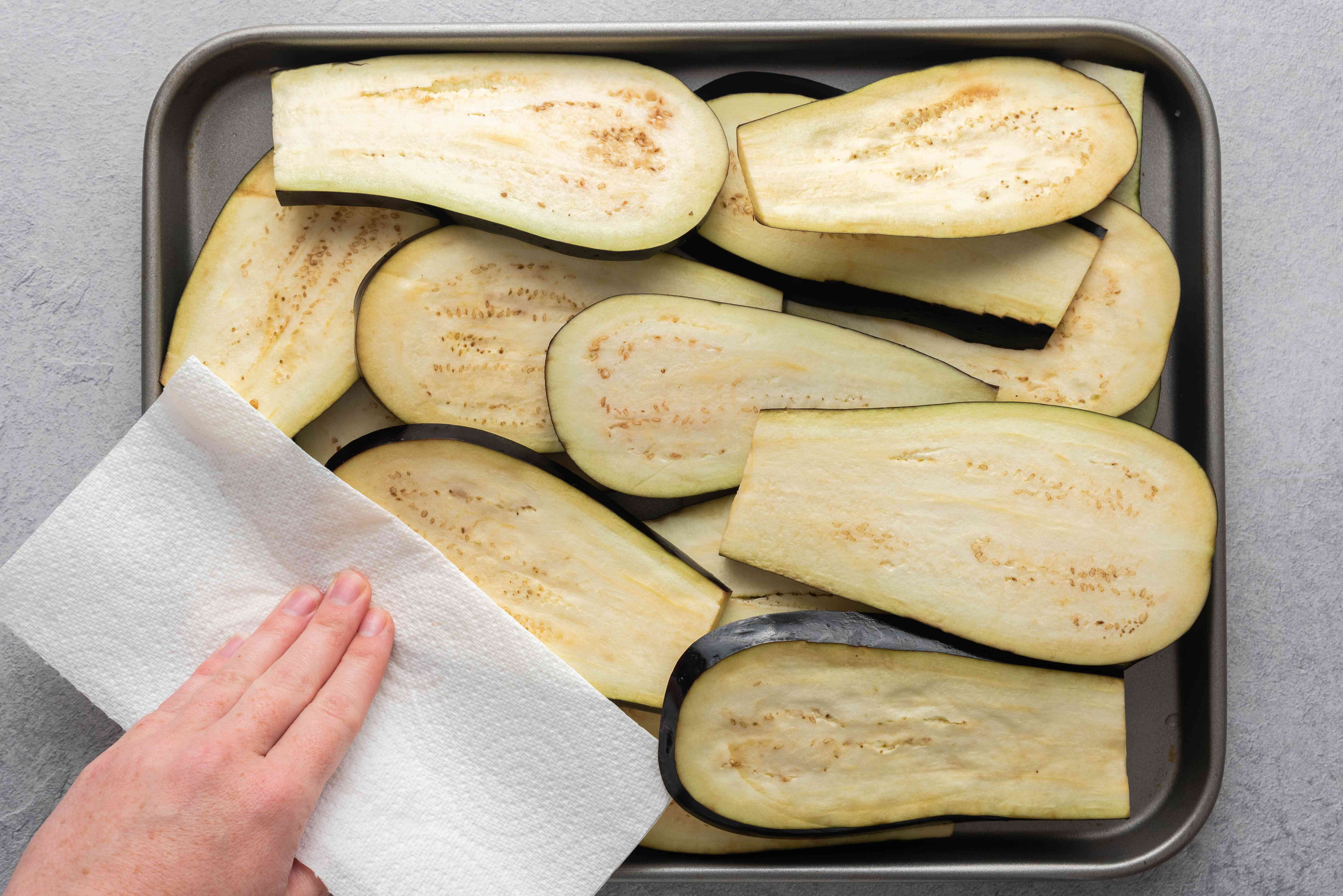 eggplants on baking sheet, patted dry with paper towel