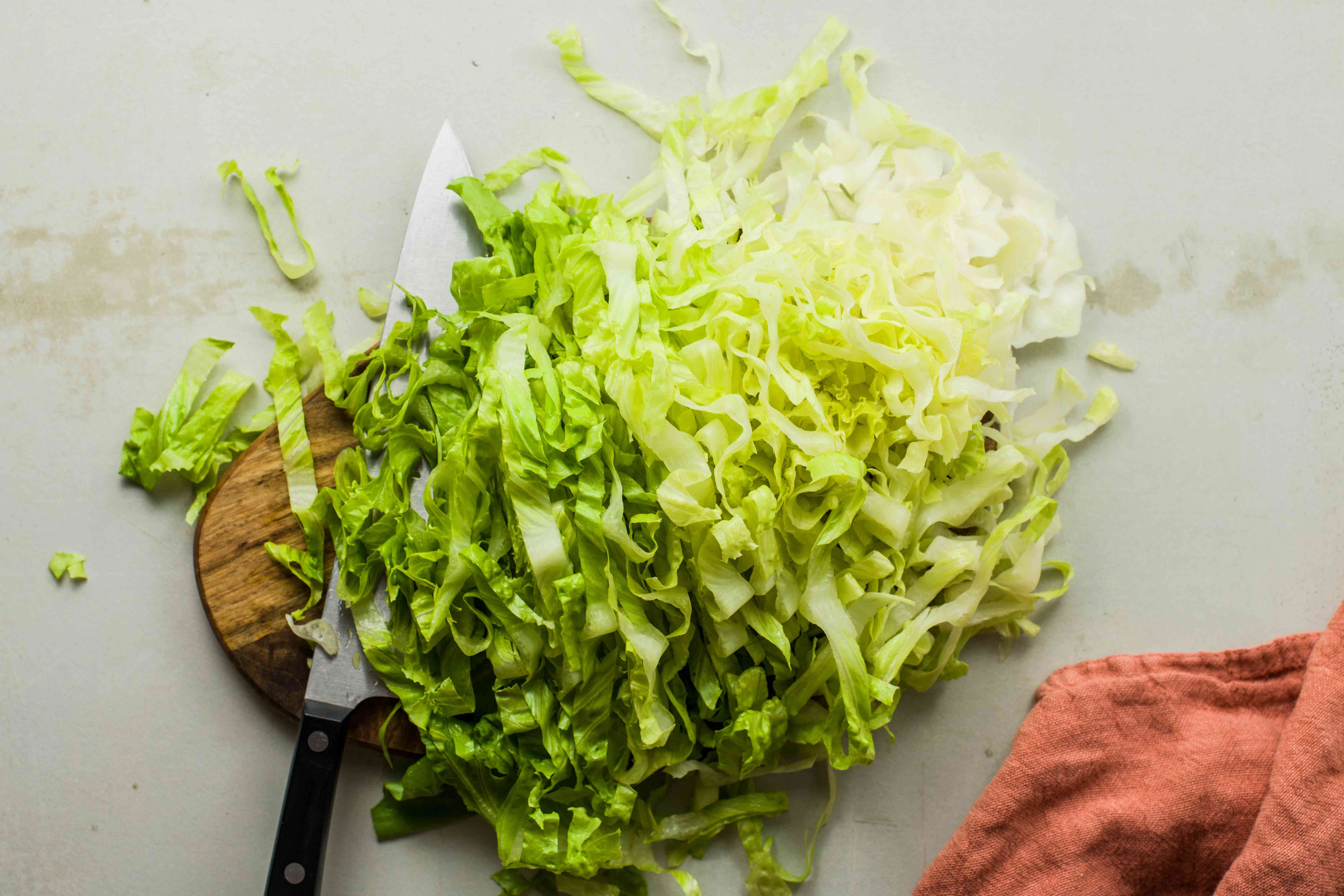 Thinly slice romaine hearts
