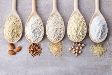 variety of gluten free low carb flours in wooden spoons