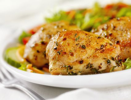 Grilled chicken thighs with a side salad