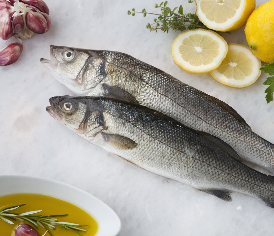 Sea bass with lemon, olive oil and herbs
