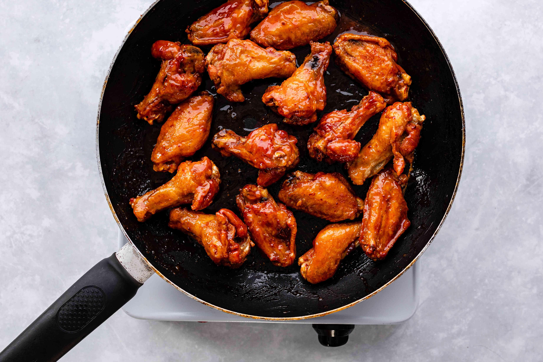 Toss Buffalo wings in sauce