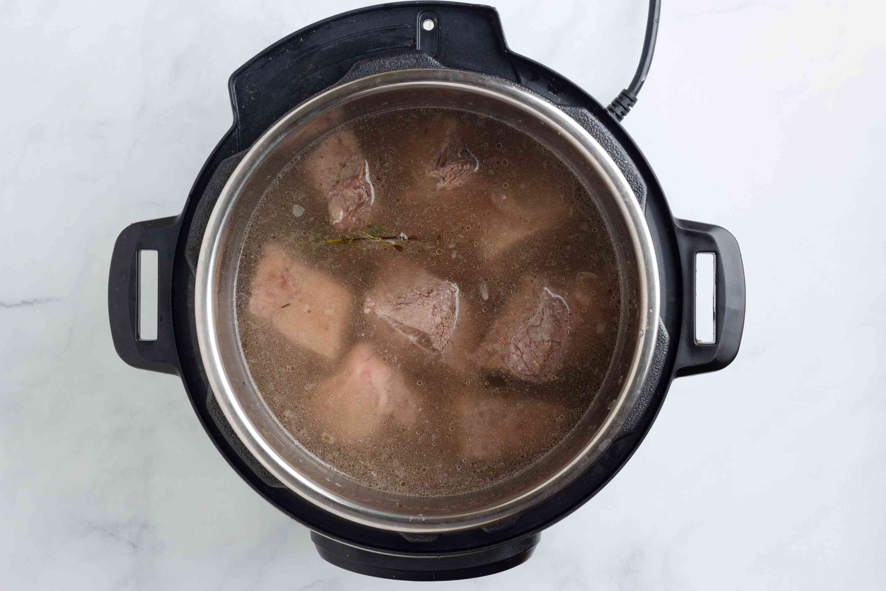 water added to the beef mixture in the pressure cooker