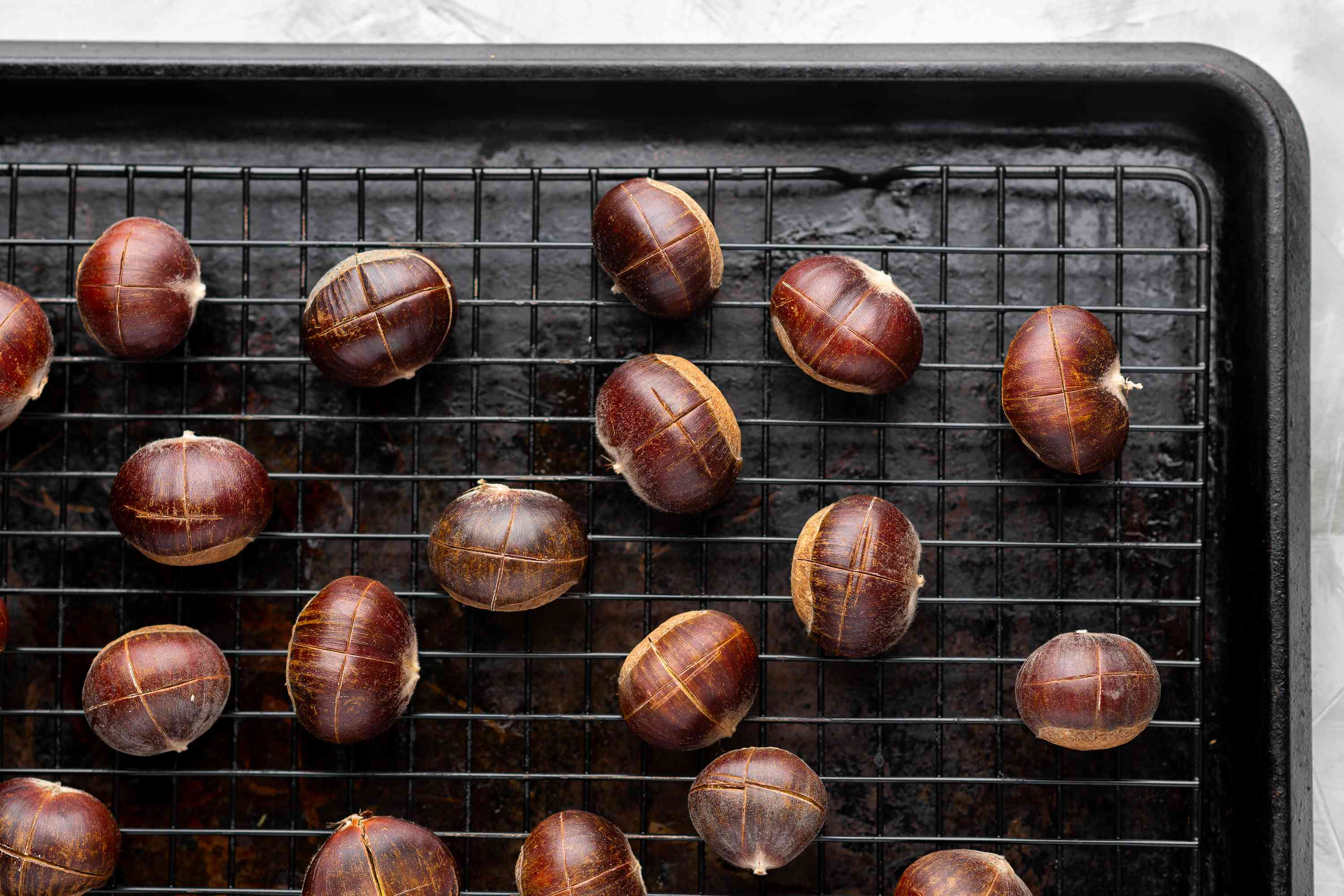The chestnuts are placed on a baking sheet