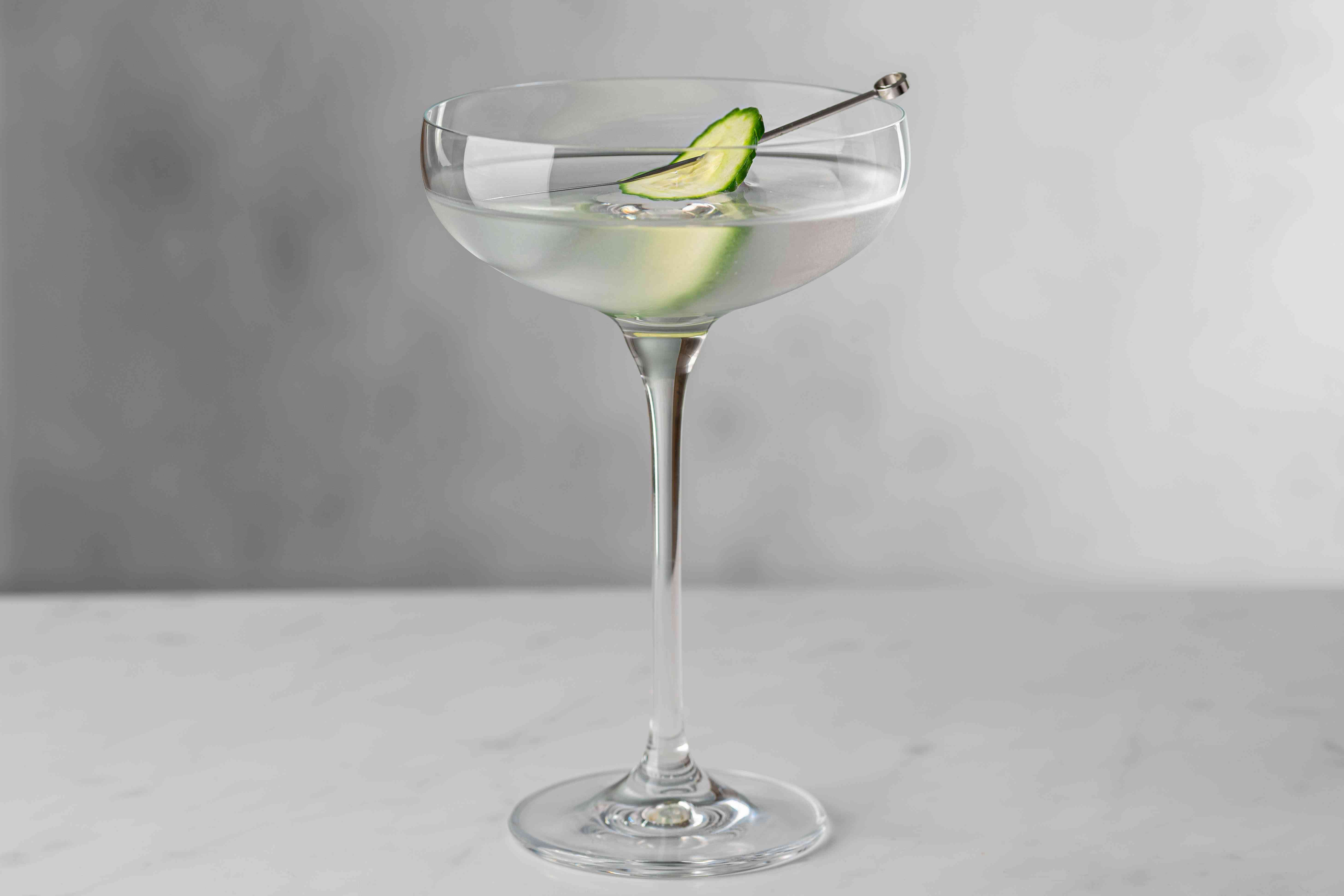 Garnish the saketini with an olive or slice of cucumber