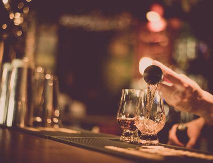 Mixing a bourbon cocktail