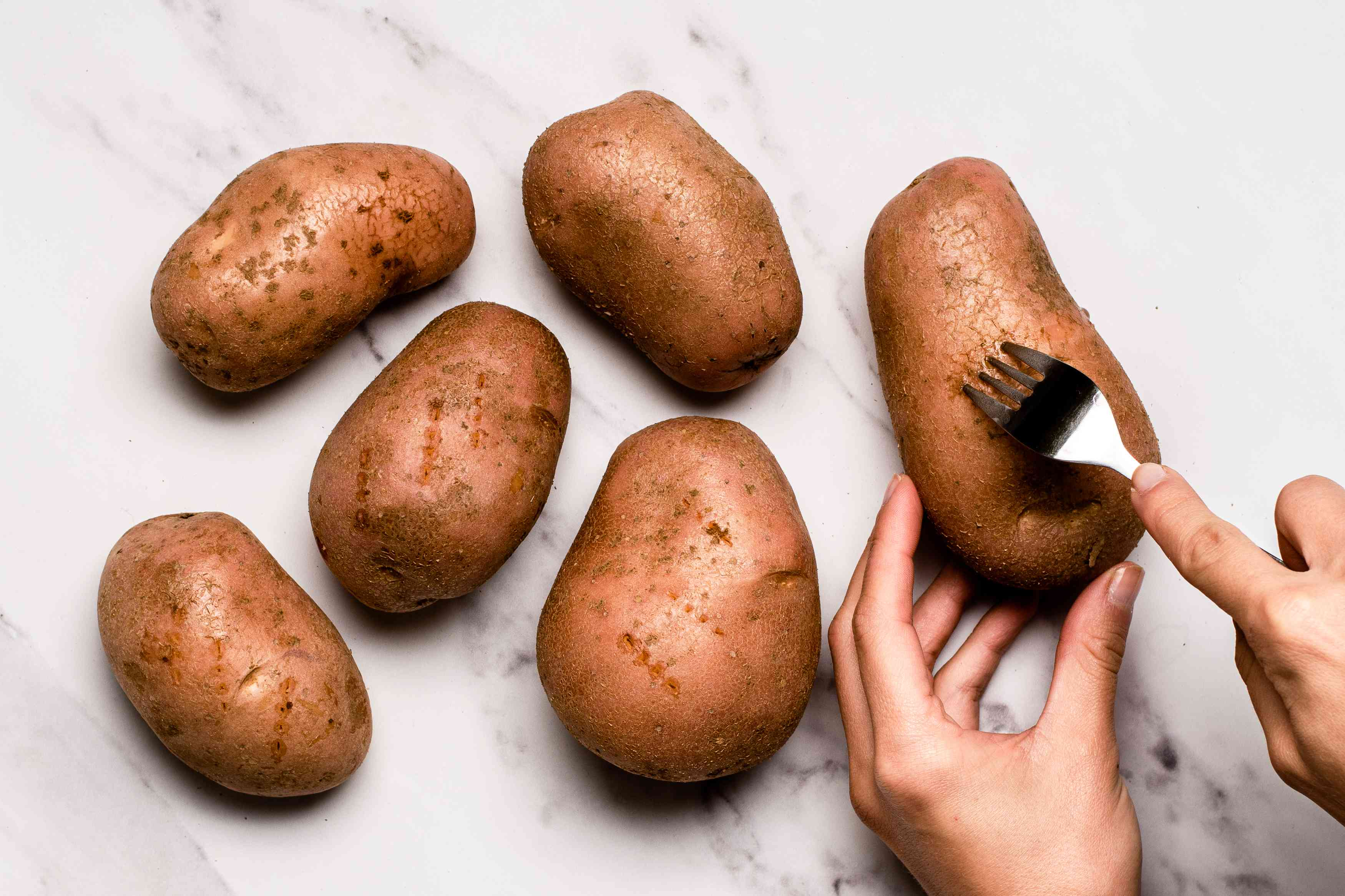 prick each potato deeply with a fork