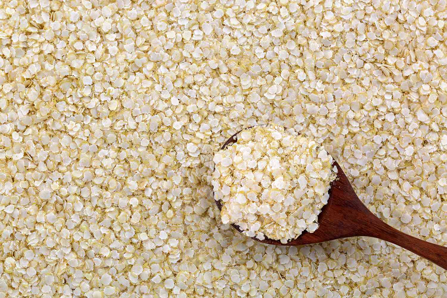 Rolled white Quinoa seed gluten-free flakes.