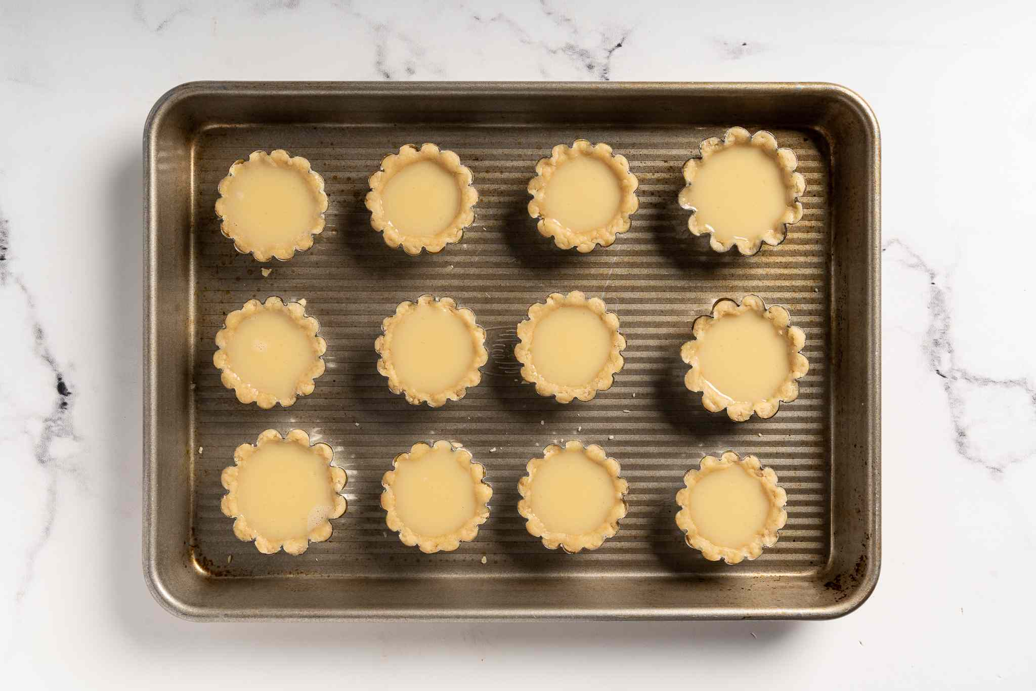 Unbaked Egg Tarts on a tray