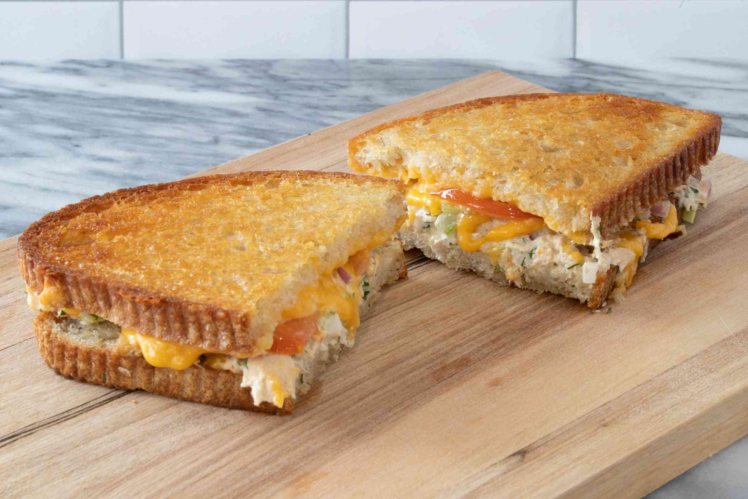 tuna melt sandwich on the cutting board