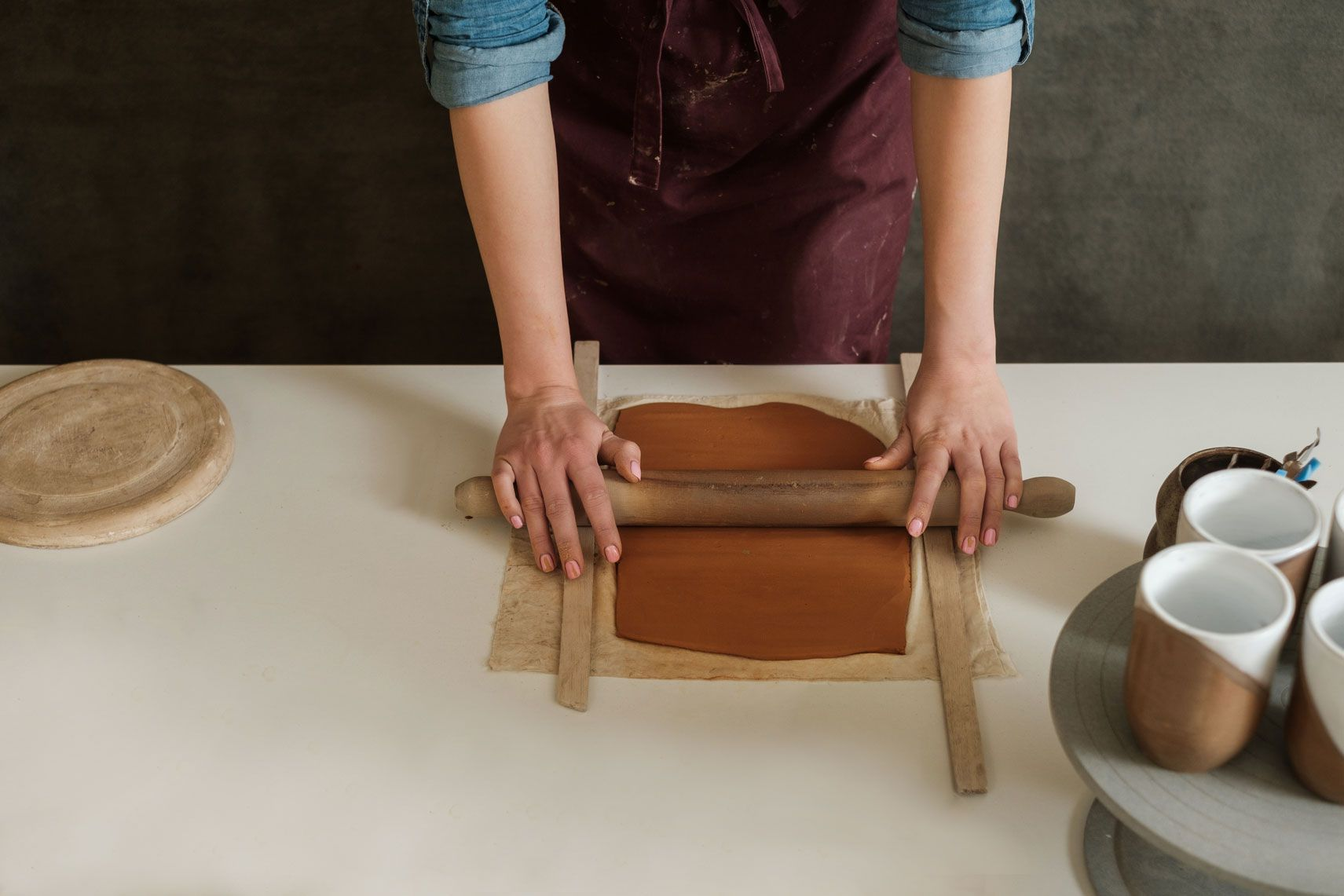 Rolling dough to an even thickness using two rulers