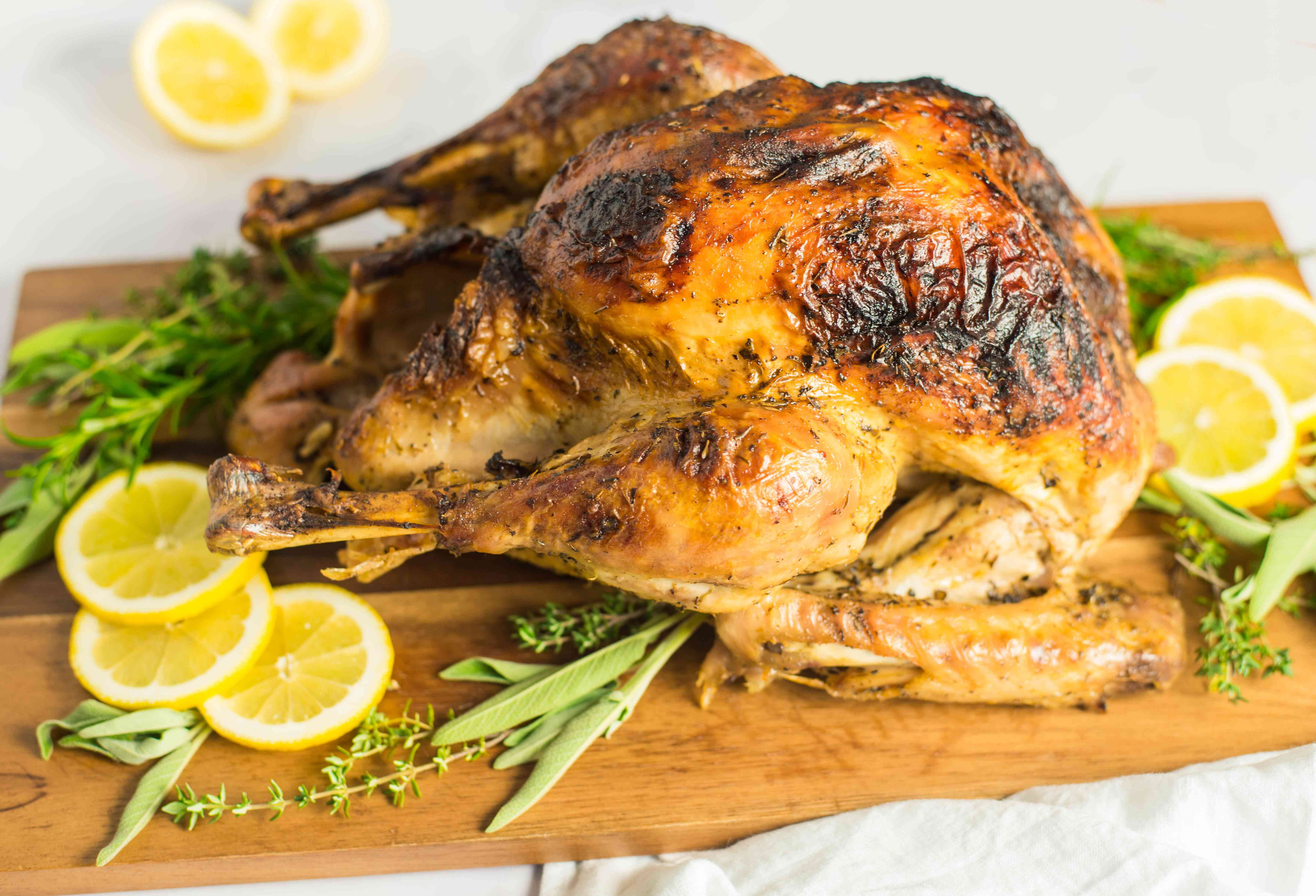 Roasted turkey with herbs and lemon slices
