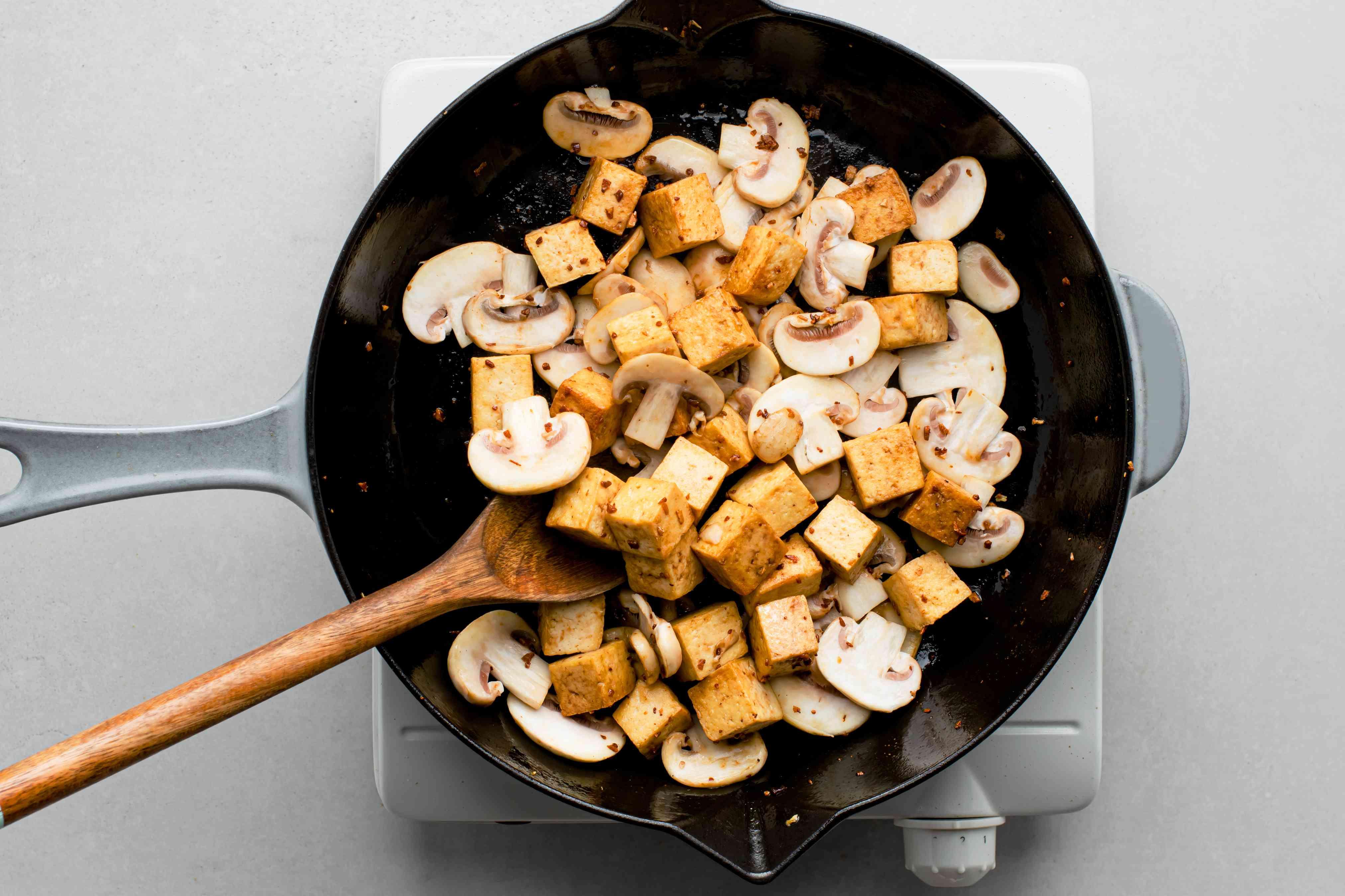 mushrooms and tofu in a skillet