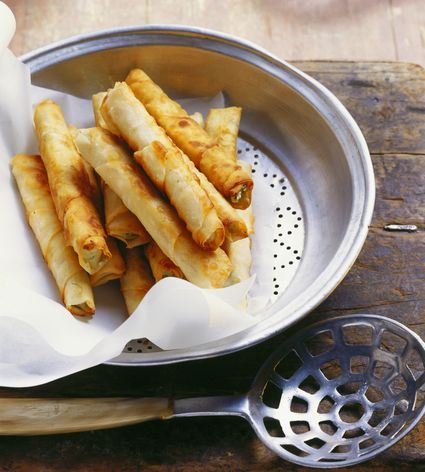 Turkish 'cigarette' pastries are fried rolls of paper-thin dough filled with salty Feta cheese.