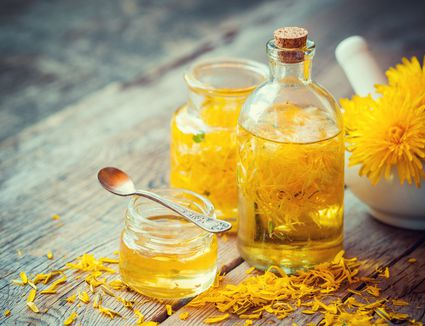 Dandelion honey in a jar with a spoon