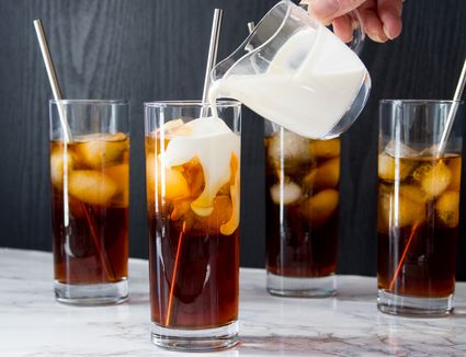 Pouring Cream Over Cold Brew Coffee