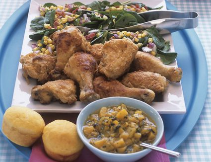 chicken drumsticks with salsa and vegetables