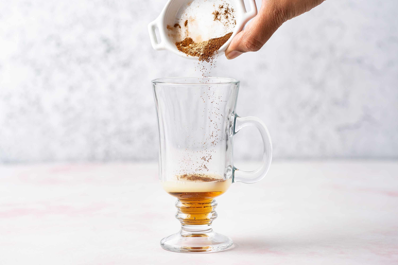 add the honey, lemon juice, and spices to an Irish coffee mug