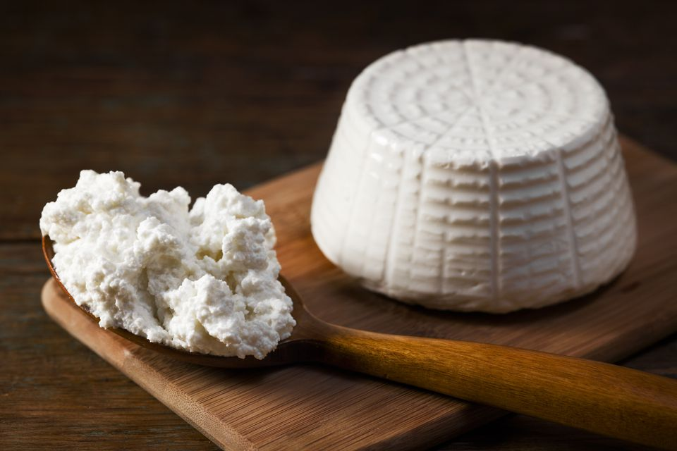 Ricotta Cheese on wooden board and spoon