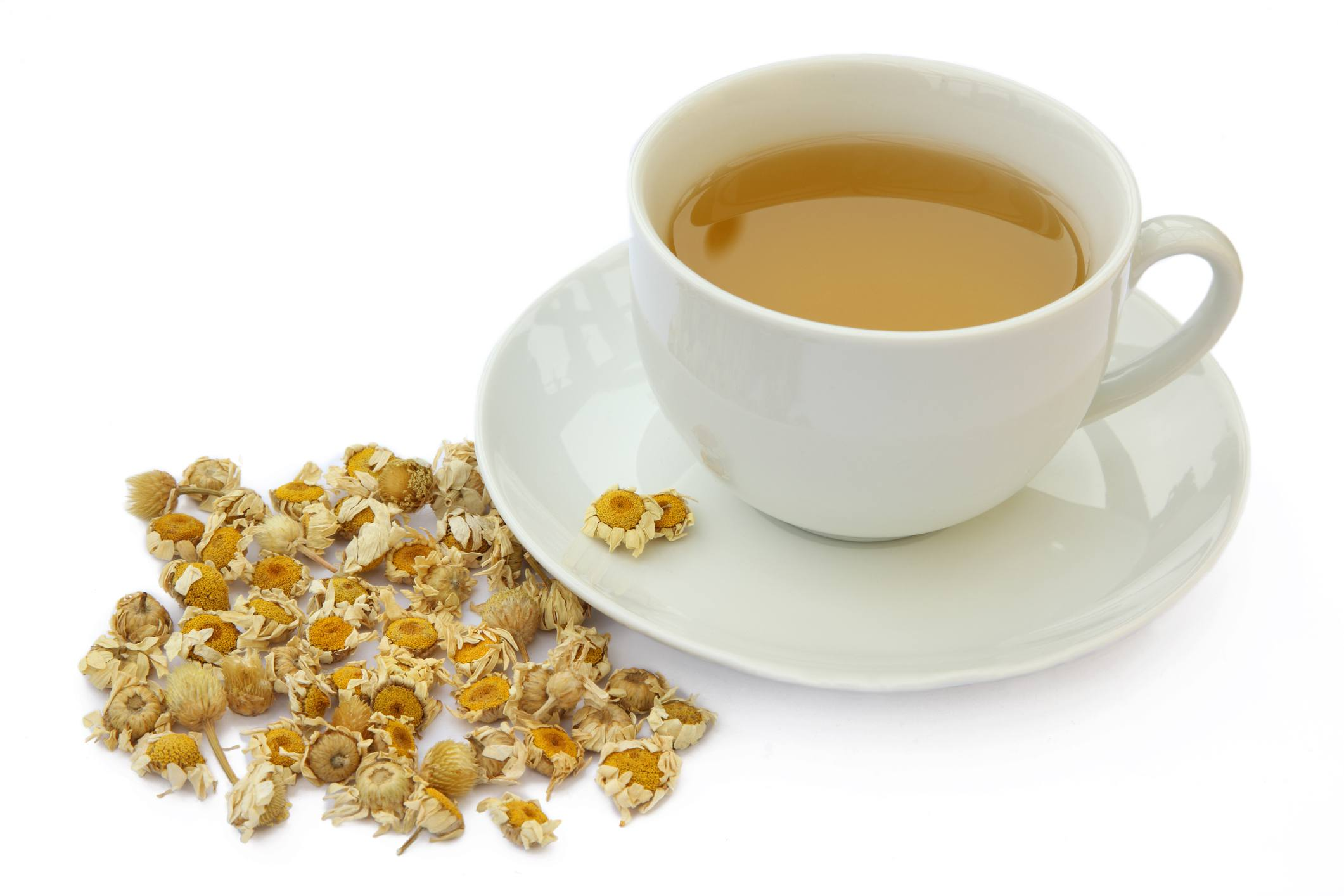 Cup of camomile tea with dried camomile flowers