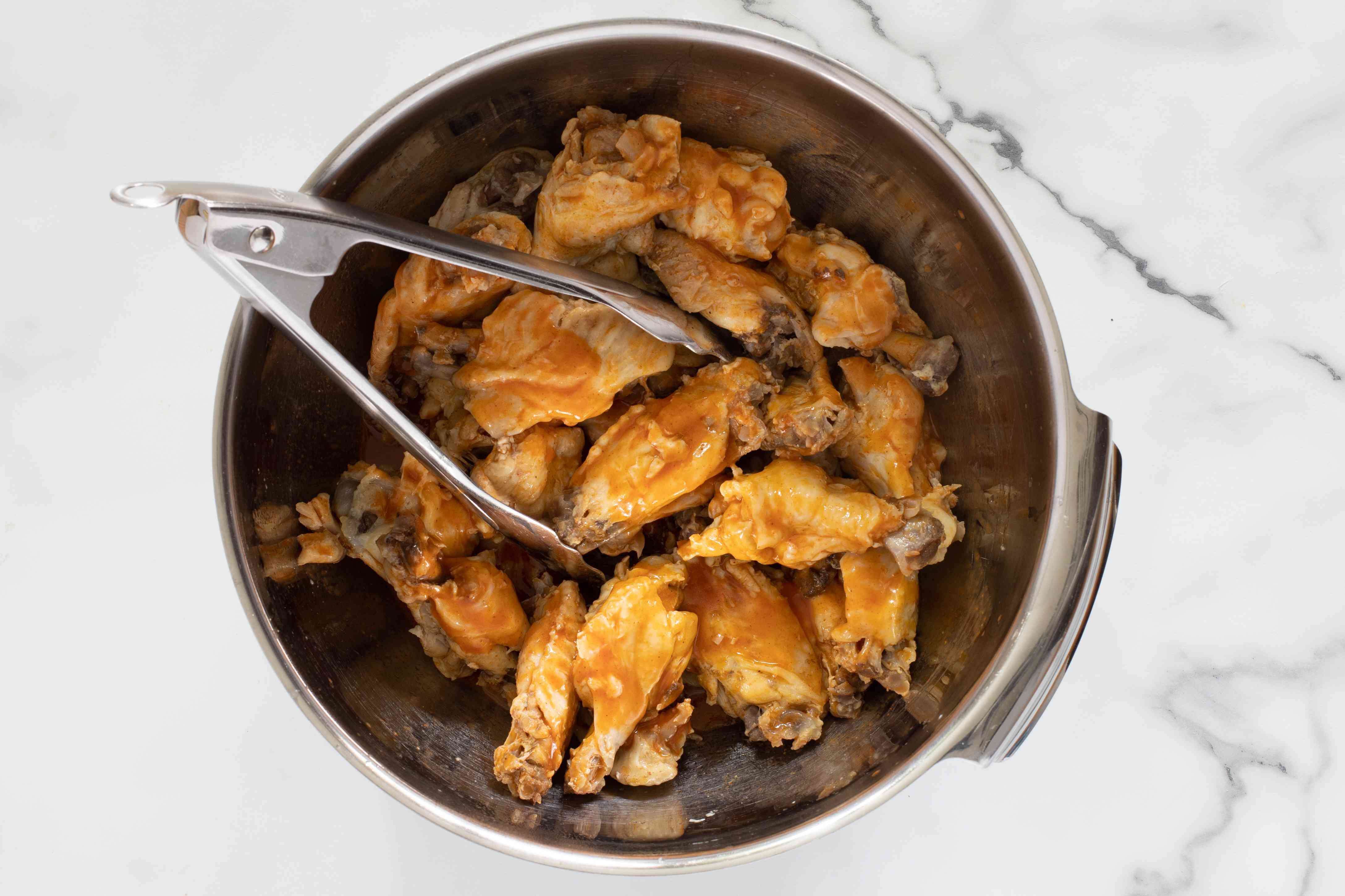 wings in a bowl with sauce