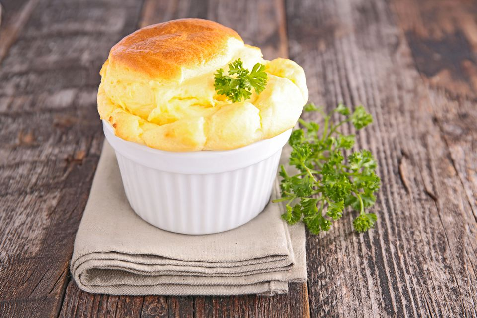 Close up of cheese souffle on napkin on wooden table