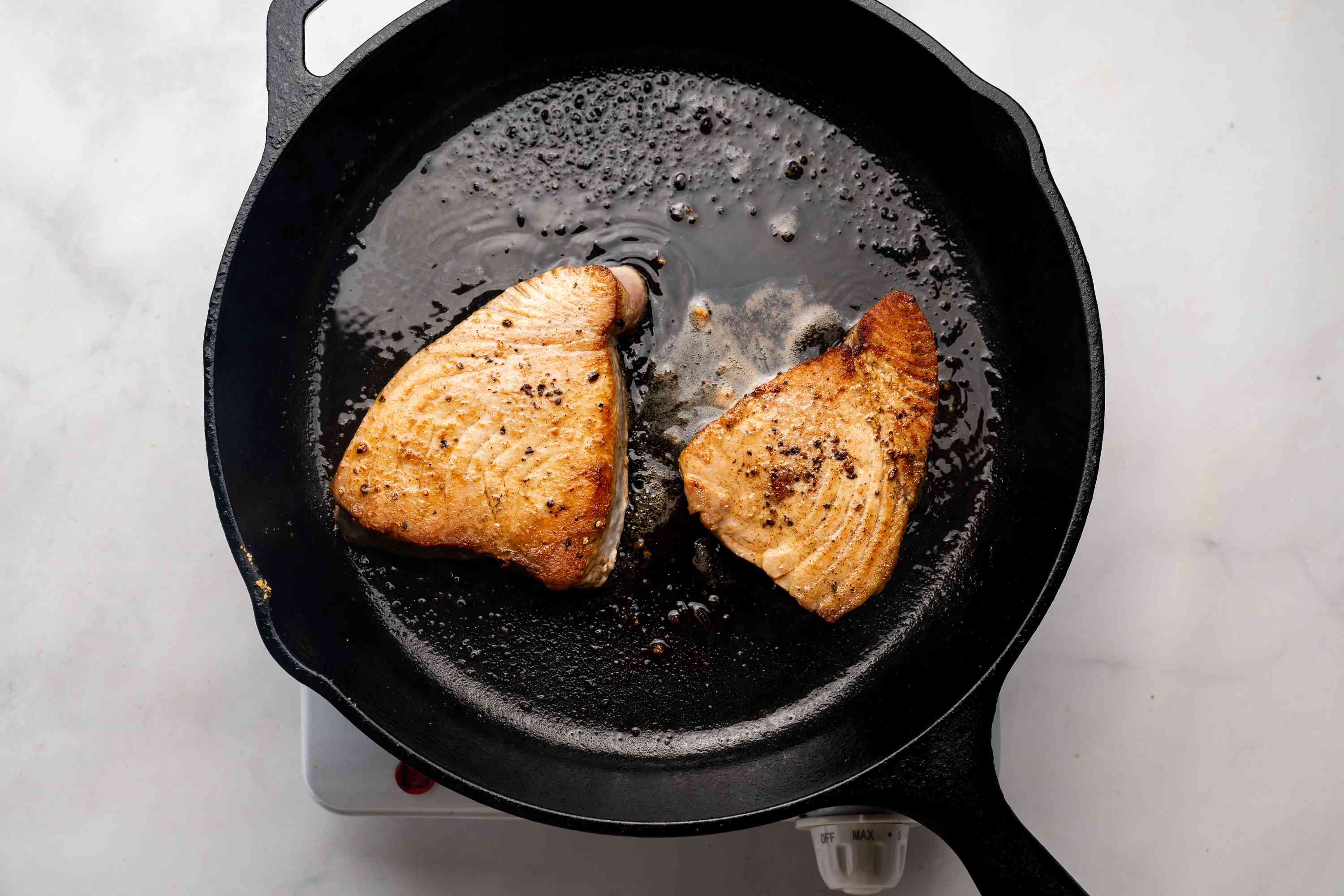 tuna steaks cooking in a skillet