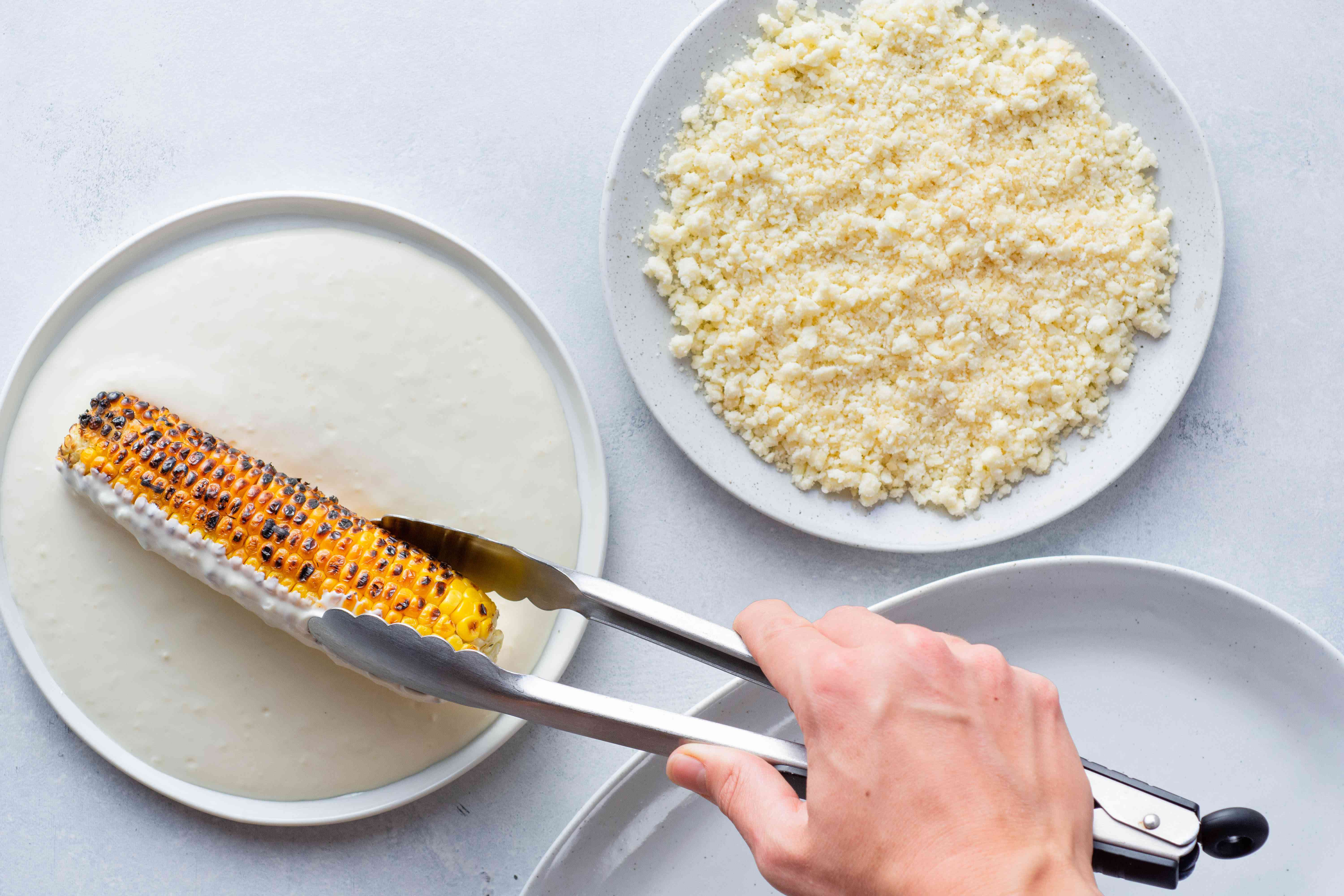 roll roasted corn in mayo mixture