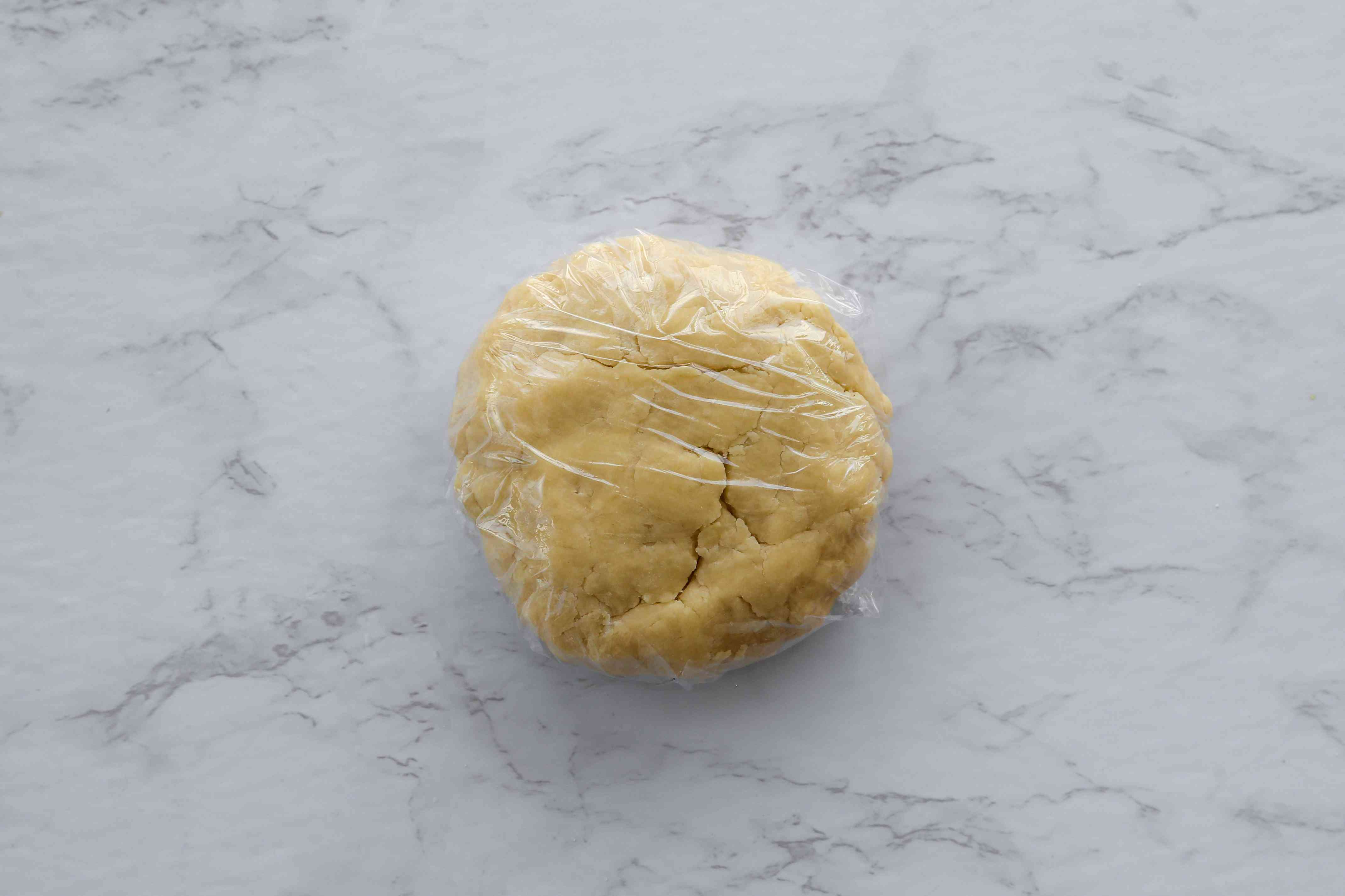 Pie pastry dough wrapped in plastic wrap