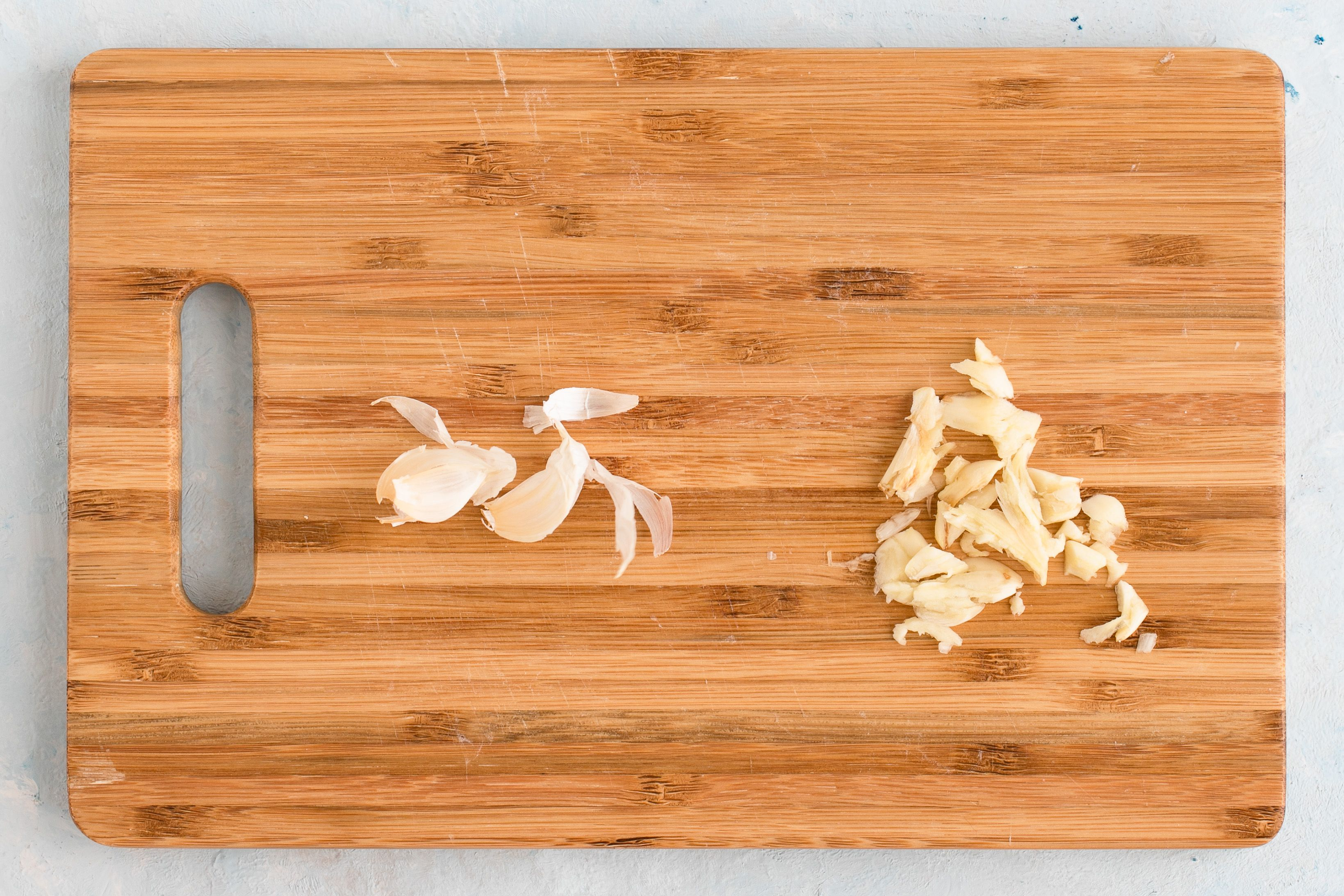 Peel and mash garlic