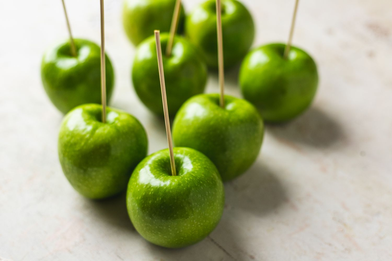 green apples with sticks in the stem end