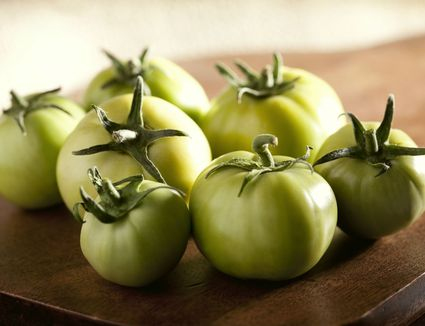 Green Tomatoes on a Rustic Wood Board
