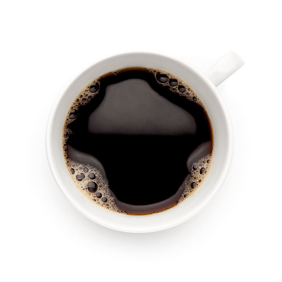 View directly above a coffee cup over a white background