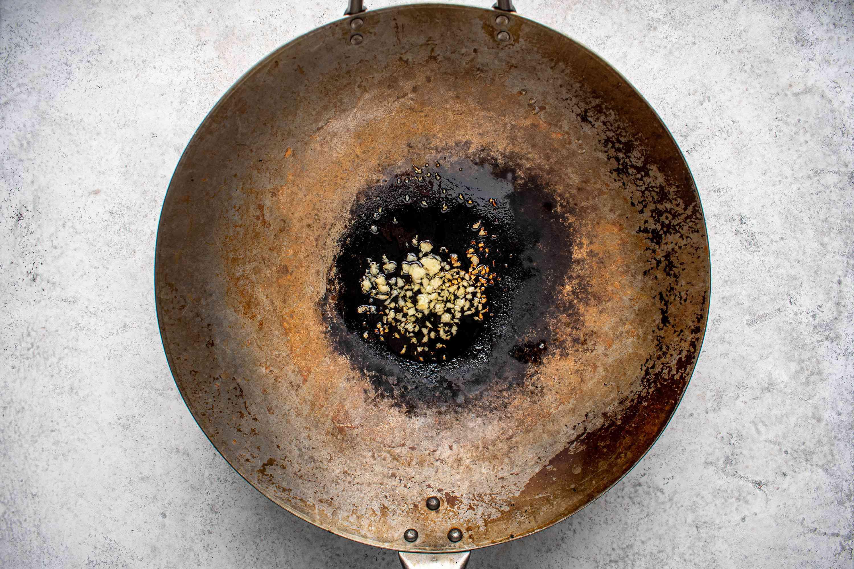 garlic cooking in a wok
