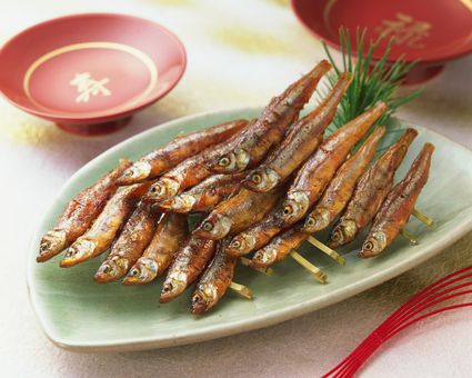 Dried fried smelt fish on skewers